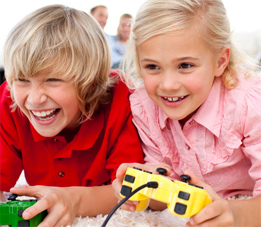 Image of kids playing an electronic game
