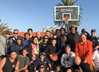 Participants and supporters at the final match of Port Phillip Council's 2 on 2 Tournament with Mayor Dick Gross (in orange) and Acting Senior Sergeant Jay McDonald.